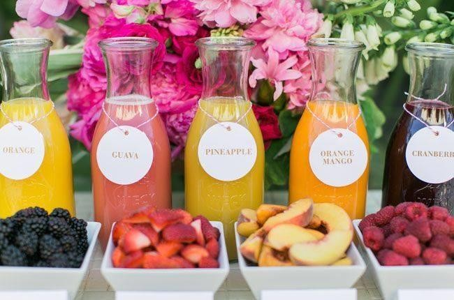 bottles of juice for mimosas with fruit