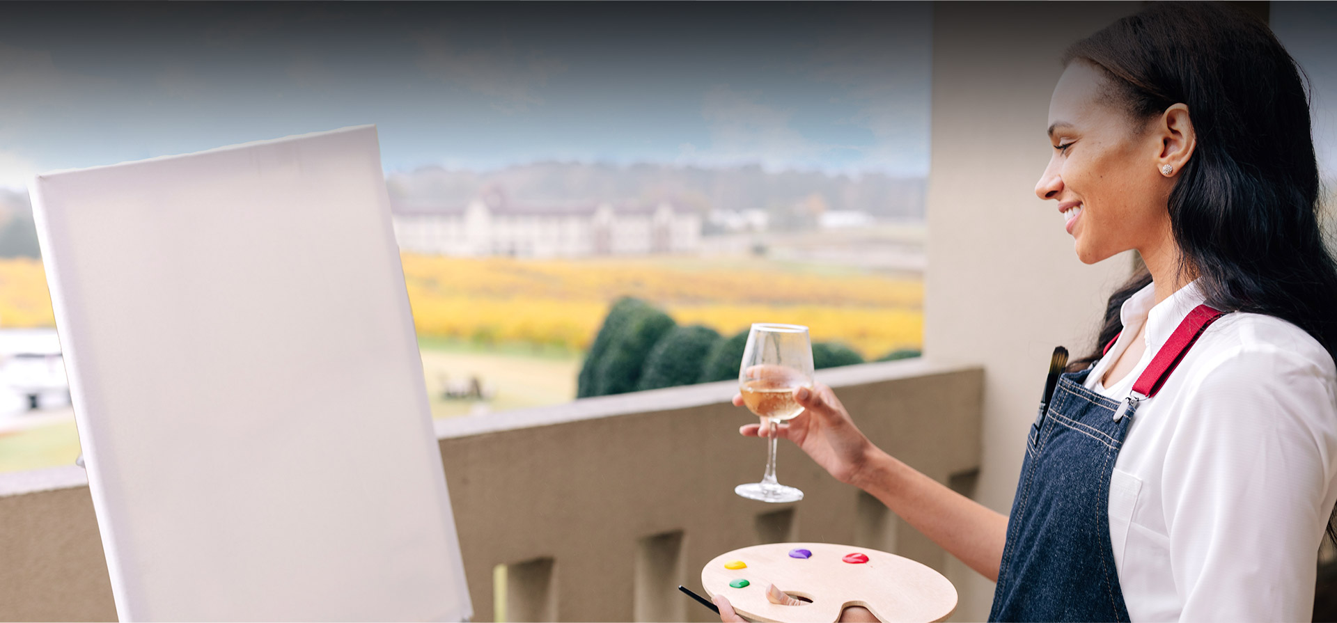 woman with a glass of wine starting painting